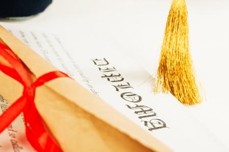 Graduation hat and Diploma  photo