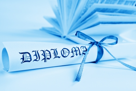 baccalaureate: Diploma with blue ribbon and book