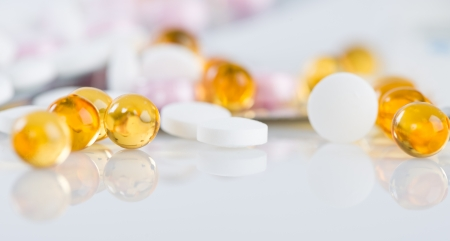 Colorful tablets with capsules  photo