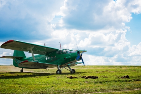 old airplane on green grass  photo