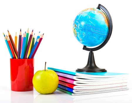 Globe, notebook stack and pencils. Schoolchild and student studies accessories. photo