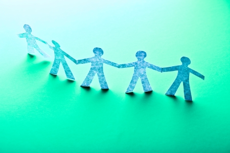 teamworking: Paper people in teamworking concept