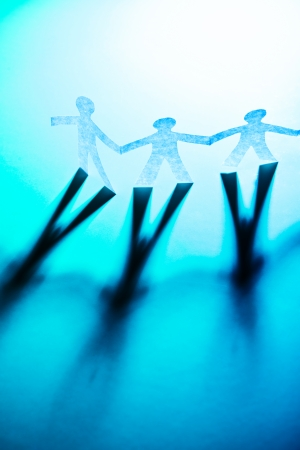 Paper people in teamworking concept Stock Photo - 22556936