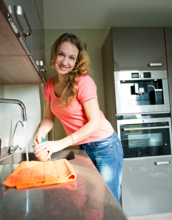 dishwashing: Happy Young Woman Washing cup. Kitchen. Dishwashing.