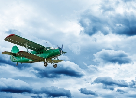Retro style picture of the biplane.  photo