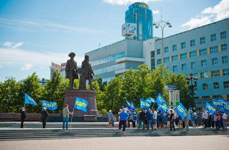 liberal: YEKATERINBURG, RUSSIA - JUNE 12: Liberal Democratic Party rally near the monument to the founders of Yekaterinburg on Juny 12, 2012. It was opened on August 14, 1998 and devoted to the 275th anniversary of Yekaterinburg.