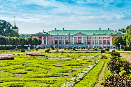 Park with statues and Palace of earl Sheremetyev in mansion Kuskovo. Moscow. Russia