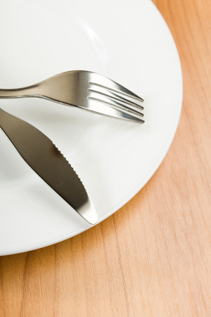 knife and fork on white plate  photo