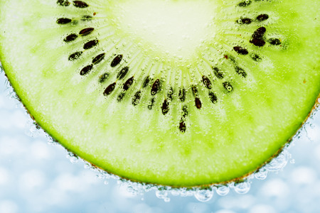 sliced kiwi covered with bubbles  photo