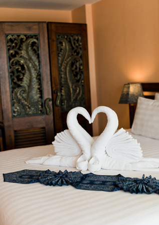 swans made from towels on the hotel bed.