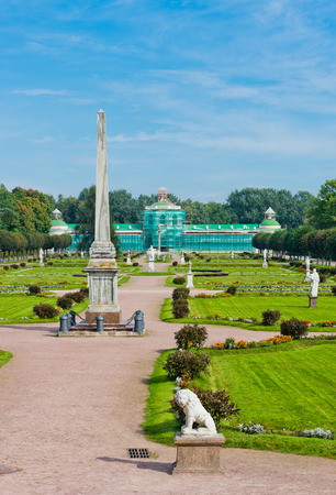 Colonna with a statue of Minerva and orangerie. Kuskovo estate, Moscow, Russia