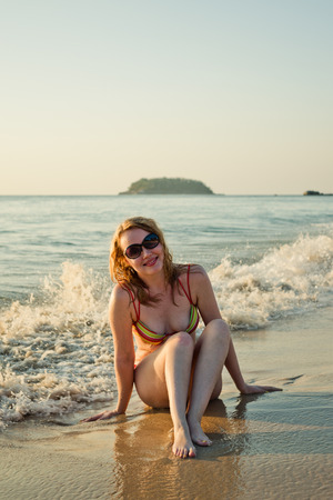Beautiful woman having a fun while swimming in the sea photo