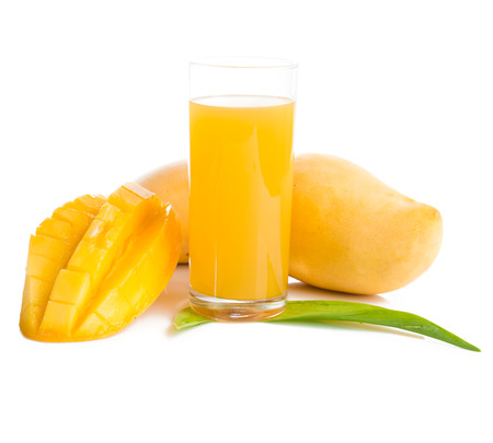 Glass of fresh mango smoothie on white.  photo