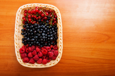 Mix of different berries in basket  photo
