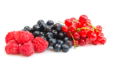Mix of different berries isolated on white  photo