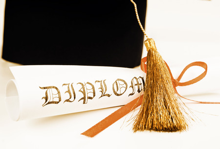 Graduation hat and Diploma  photo