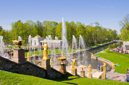 referred: ST. PETERSBURG, RUSSIA - MAY 19 2012. Fountains of Petergof. Petergof Palace is a series of palaces and gardens sometimes referred as the a Russian Versailles.