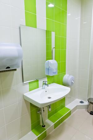 a clean new public toilet room empty  photo