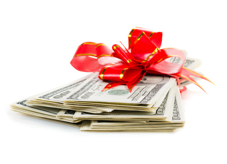 Christmas Bonus Stack of Cash With Red Bow Isolated on White Back Ground.  photo
