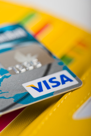 YEKATAERINBURG, RUSSIA - APR 25, 2014: Visa Debit Card  in wallet and other cards.