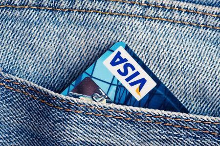 YEKATAERINBURG, RUSSIA - APR 25, 2014: Visa Debit Cards in blue denim jeans pocket. VISA is one of the three biggest brands.