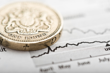 budget: One pound coin on fluctuating graph. Rate of the pound sterling  Stock Photo