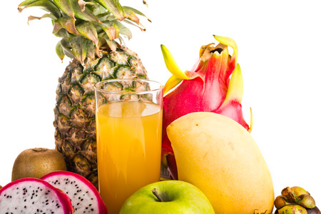 juice in glass and tropical fruit on white  photo