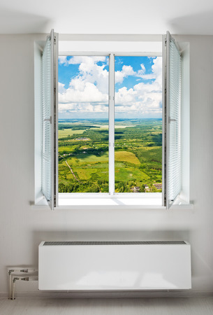 double glass: White open double door window with radiator under it. Domestic room.
