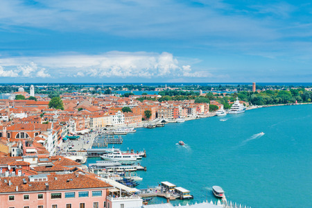 Beautiful views of the Mediterranean traditional houses Venice with red tile roofs from Campanile di San Marco. Venice, Italy, Europe  photo