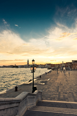 Sunset over embankment in Venice  photo