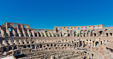 ROME, ITALY - JULY 16, 2014: inside of Colosseum in Rome, Italy. The Colosseum is an important monument of antiquity and is one of the main tourist attractions of Rome.