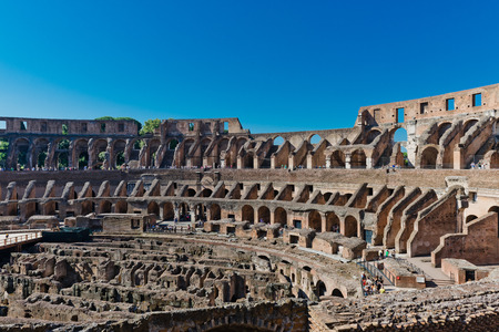 emporium: ROME, ITALY - JULY 16, 2014: inside of Colosseum in Rome, Italy. The Colosseum is an important monument of antiquity and is one of the main tourist attractions of Rome.