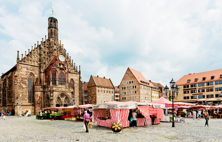 bayern old town: NUREMBERG, GERMANY JULY 22:  Market near Frauenkirche (Our Ladys Church) in Neurenburg. Nuremberg accommodates annually more than 2 millions tourists