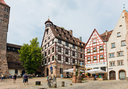 lived here: NUREMBERG, GERMANY JULY 22: Day view of Albrecht Durers House in Nuremberg, Germany. Albrecht Durer bought this house in 1509, and lived here until his death in 1528.  Editorial