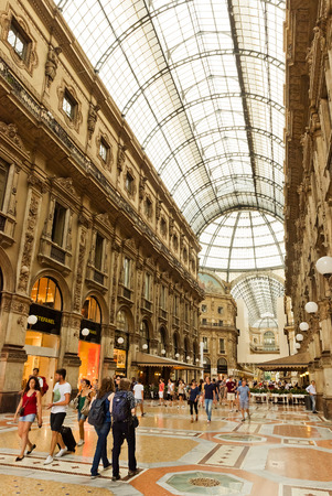 MILAN, ITALY - JULY 20 2014: view of Galleria Vittorio Emanuele II  in Milan. Built in 1875 this gallery is one of the most popular shopping areas in Milan.