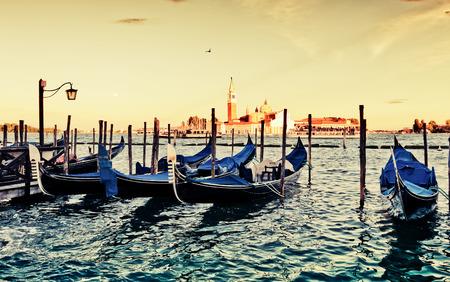 saint mark square: Gondolas moored by Saint Mark square with San Giorgio di Maggiore church in the background - Venice, Italy