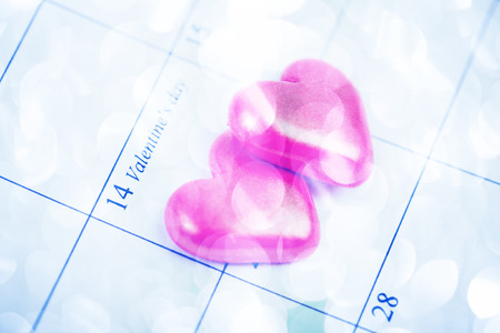 Calendar page with the red hearts on February 14 of Saint Valentines day. photo