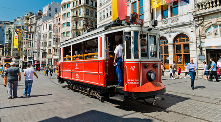 street shots: ISTANBUL, TURKEY - AUGUST 27 2013: Retro tram moves along a busy Istiklal street in Istambul.  It is the most famous street in Istanbul, visited by nearly 3 million people in a single weekends day
