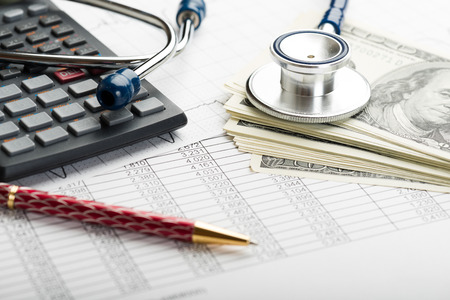 Health care costs. Stethoscope and calculator symbol for health care costs or medical insurance Фото со стока - 33475111