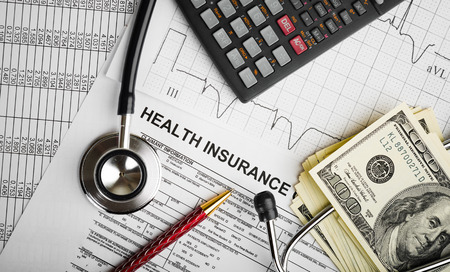 problem health: Health care costs. Stethoscope and calculator symbol for health care costs or medical insurance