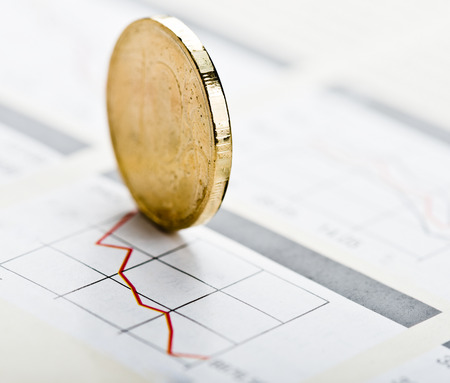 financial figure: Financial graphs and coin. Stock Photo