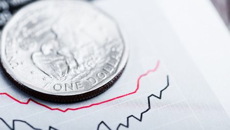 american coin on fluctuating graph. Rate of the dollar (shallow DOF) photo