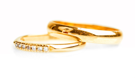 golden ring: Gold wedding rings isolated on white background