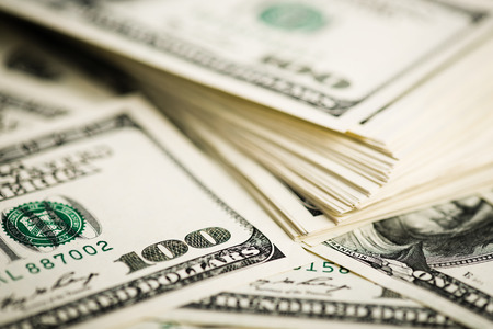 Stack of one hundred dollar bills close-up. (shallow DOF) photo
