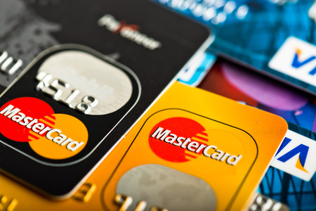mastercard: YEKATAERINBURG, RUSSIA - JAN 07, 2015: Pile of credit cards, Visa and MasterCard. Visa and Mastercard are a two biggest credit card companies in the world. Editorial