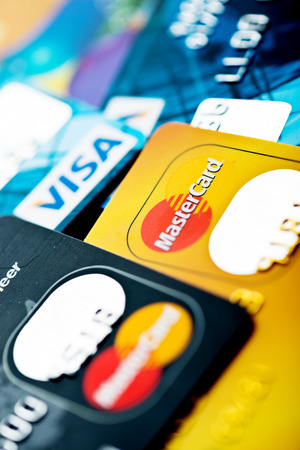 YEKATAERINBURG, RUSSIA - JAN 07, 2015: Pile of credit cards, Visa and MasterCard. Visa and Mastercard are a two biggest credit card companies in the world. Editorial