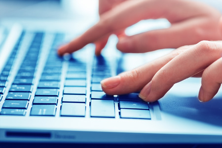 Close-up of typing female hands on keyboard 스톡 콘텐츠