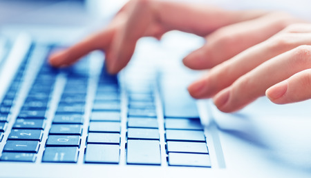 peripherals: Close-up of typing female hands on keyboard Stock Photo