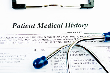 medical history: Medical history document with medicine and stethoscope