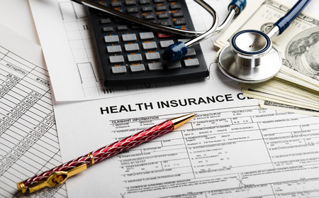 health care costs: Health care costs. Stethoscope and calculator symbol for health care costs or medical insurance